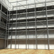 3d scaffolding and renovated wall — Stok fotoğraf