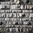 Old stone bricks wall pattern texture with deep shadows — Stock Photo