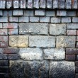 Stock Photo: Old stone wall filled with bricks texture