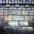 Old stone wall filled with bricks texture — Stock Photo