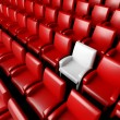 Empty cinema hall with auditorium and one reserved seat — Stock Photo #9546902