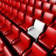 Empty cinema hall with auditorium and one reserved seat — Stock Photo