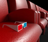 Empty cinema hall and 3d glasses — Stock Photo