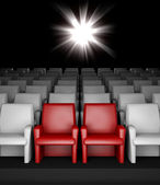 Empty cinema hall with auditorium and two reserved seat — Stock Photo