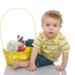 Cute little boy with Bunny and Easter eggs in yellow basket — Stock Photo