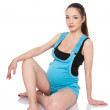 Pregnant woman doing gymnastic exercise — Stock Photo