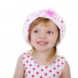 Smiling baby girl wearing a hat with a flower — Stock Photo #9917021