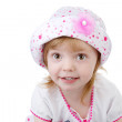 Smiling baby girl wearing a hat with a flower — Stock Photo