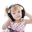 Stock Photo: Girl listening to music on headphones.