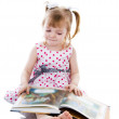 Baby girl reading a book. — Stock Photo