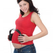 Young pregnant woman with headphones on tummy — Stock Photo
