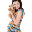 Beautiful pregnant womholding toy in anticipation of playing with her baby. — Foto Stock #9917129