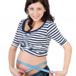 Young pregnant woman measuring belly — Stock Photo #9917137
