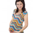 Studio portrait of beautiful pregnant woman holding her belly — Stock Photo