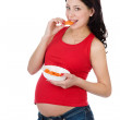 Royalty-Free Stock Photo: Beautiful pregnant woman eating salad