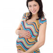 Stock Photo: Studio portrait of beautiful pregnant woman holding her belly