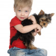 Royalty-Free Stock Photo: The child embraces a puppy.