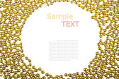 Rám vyrobený z malé zlaté cukroví — Stock fotografie