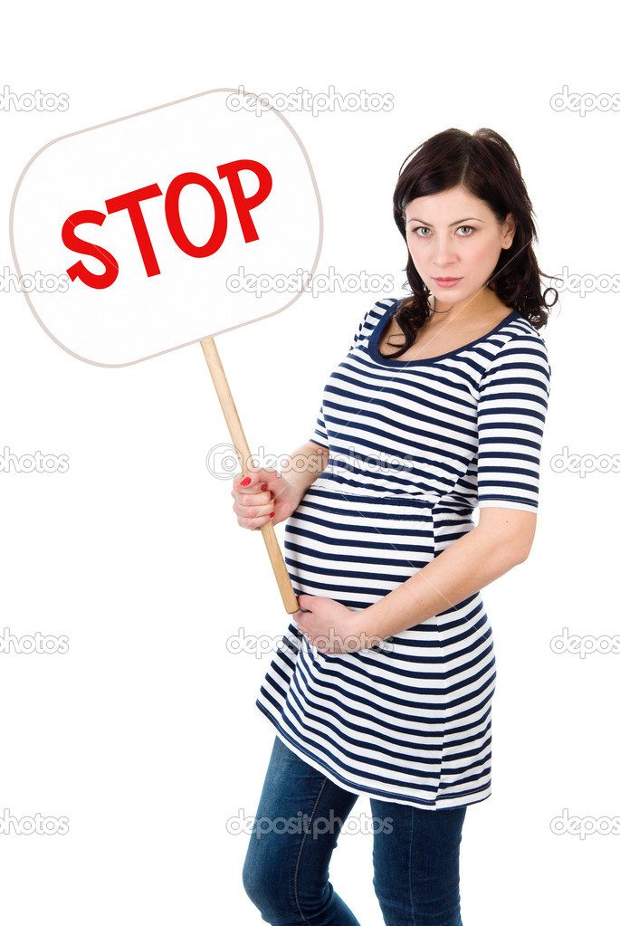 The angry pregnant woman holds the poster with an inscription Stop Isolated on a White Background — Stock Photo #9917154