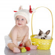 Smiling baby girl with easter eggs and bunny. — Stock Photo