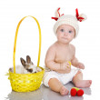 Baby girl and little easter bunny inside a basket. - Stock Photo