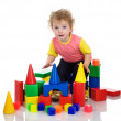 Stock Photo: Little boy playing with building blocks.