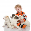 Stock Photo: Baby boy with puppy dog.