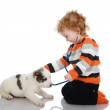 Cute kid making a checkup of a puppy dog. — ストック写真