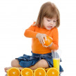 Girl squeezes orange juice. — Stock Photo