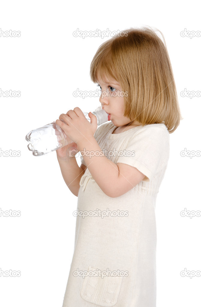 Baby is drinking water from bottle. isolated on white background  Stock Photo #9922452