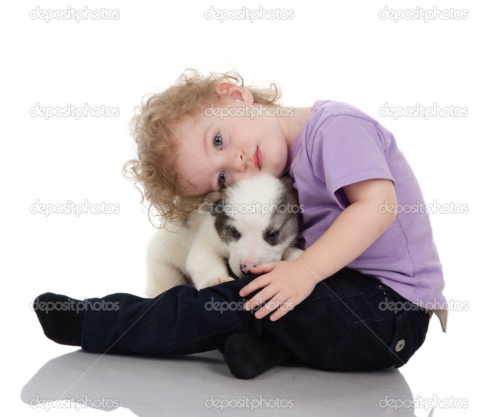 Baby boy embraces a puppy dog. isolated on white background  Stock Photo #9922497