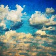 Blue vintage sky with a white clouds. - Stock Photo