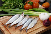 Fish with garnishing — Stockfoto