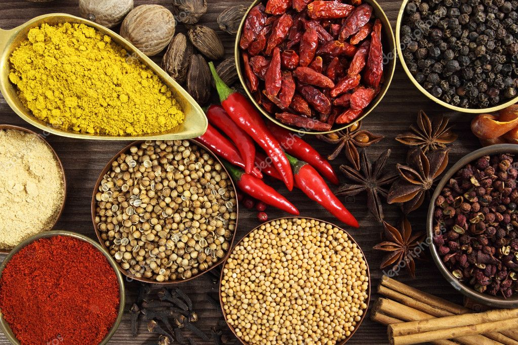 Spices and herbs in metal  bowls. Food and cuisine ingredients. Colorful natural additives. — Stock Photo #10423104