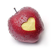 Red apple with a heart symbol — Stock Photo