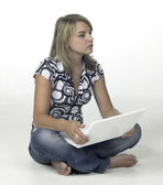Cute blonde computing girl - contemplative — Stock Photo