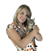 Smiling blond girl and holding a cat — Stock Photo