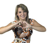 Blond girl showing heart symbol with two hands — Stock Photo