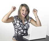 Laughing cute blond girl with laptop in light back — Stock Photo