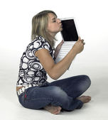 Cute blonde girl kissing her laptop — Stock Photo