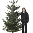 Woman and christmas tree — Stock Photo #8230212