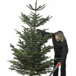 Woman and christmas tree — Stock Photo #8230217