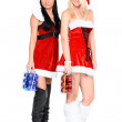 Two santa woman and christmas balls in box — Stock Photo