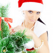 Royalty-Free Stock Photo: Beautiful woman near a Christmas tree