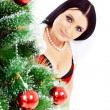 Beautiful woman near a Christmas tree — Photo