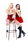 Christmas girls sitting on th stool — Stock Photo