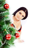 Beautiful woman near a Christmas tree — Stock Photo