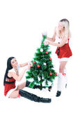 Pretty girls decorating Christmas tree — Stock Photo