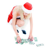Christmas girl collecting dollars — Stockfoto