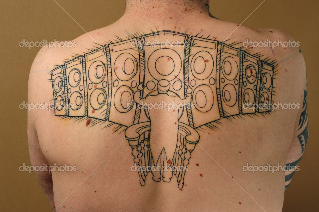 Orchestra conductor and speakers tattooed on the back  Stock Photo #9354573